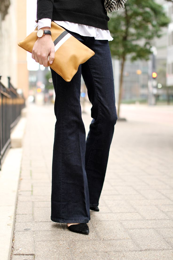 fashion-jackson-denim-flare-jeans-black-pumps-clare-v-clutch-daniel-wellington-watch
