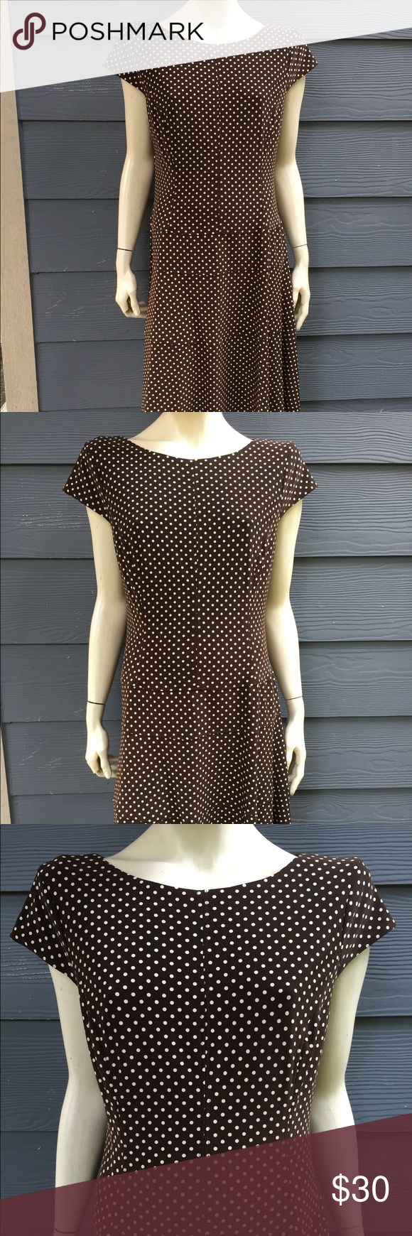 "Anne Klein Women's Dress Brown Ivory Stretch Sz 16 Anne Klein Women's Dress Brown Ivory Polka Dot Cap Sleeve Stretch Back Zip Top Lined Size 16  Measurements laying flat approximate: Armpit to armpit 20 3/4"", waist 18"", hips 23 1/2"", length 40"".  THIS GORGEOUS DRESS HAS BEEN GENTLY WORN AND OVERALL IN GREAT CONDITION!  NOTE:  PLEASE REVIEW MEASUREMENTS CAREFULLY BEFORE PURCHASING THIS ITEM SINCE SIZES SOME TIMES ARE DIFFERENT FROM BRAND TO BRAND. Anne Klein Dresses Midi"