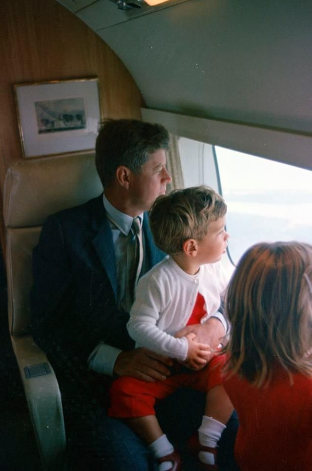 John F.Kennedy And His Family President John F. Kennedy and John F. Kennedy, Jr., sit aboard a helicopter en route from Hyannis Port to Otis Air Force Base, Cape Cod, Massachusetts, during Labor Day weekend- JFK Library.