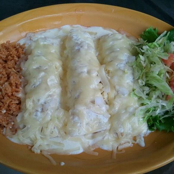 Uncle Julio's Chicken Enchiladas with sour cream sauce....Yum!