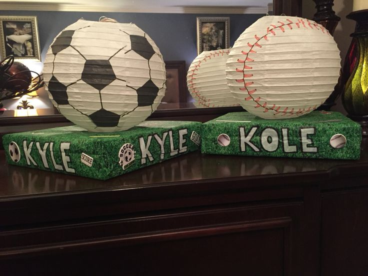 Sports Valentine boxes for Boys! I made these for my boys out of a table cloth that looks like grass and a baseball and soccer paper lantern. They were a HUGE hit!!