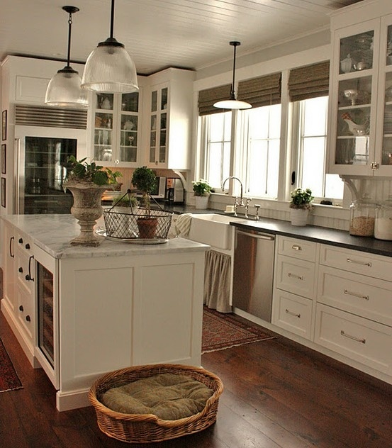 Beadboard ceiling and backsplash. Big windows with roman shades. White cabinets. Marble counter tops. Dark wood floors.  Its my dream kitchen!