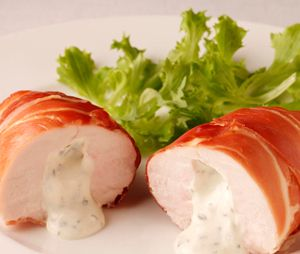 Oven baked chicken in Parma ham.Cream cheese herb stuffed chicken breasts wrapped in Parma ham and cooked in turbo oven.