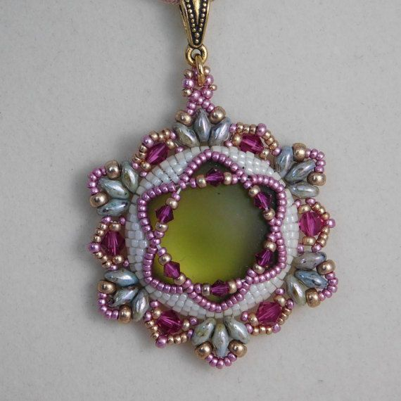 Hannah Pendant Tutorial  This is a lovely pendant tutorial featuring a Lunasoft cabochon which glows from the center surrounded by sparkley Swarovski bicones and Superduos. The tutorial has step by step photos and instructions to guide you through every step to make the pendant. This listing is for the tutorial only. No finished pendant is included. The finished pendant is 45mm.  Materials needed to make this pendant:  24mm Lunasoft cabochon Superduos 3mm and 4mm bicones Delica beads size…