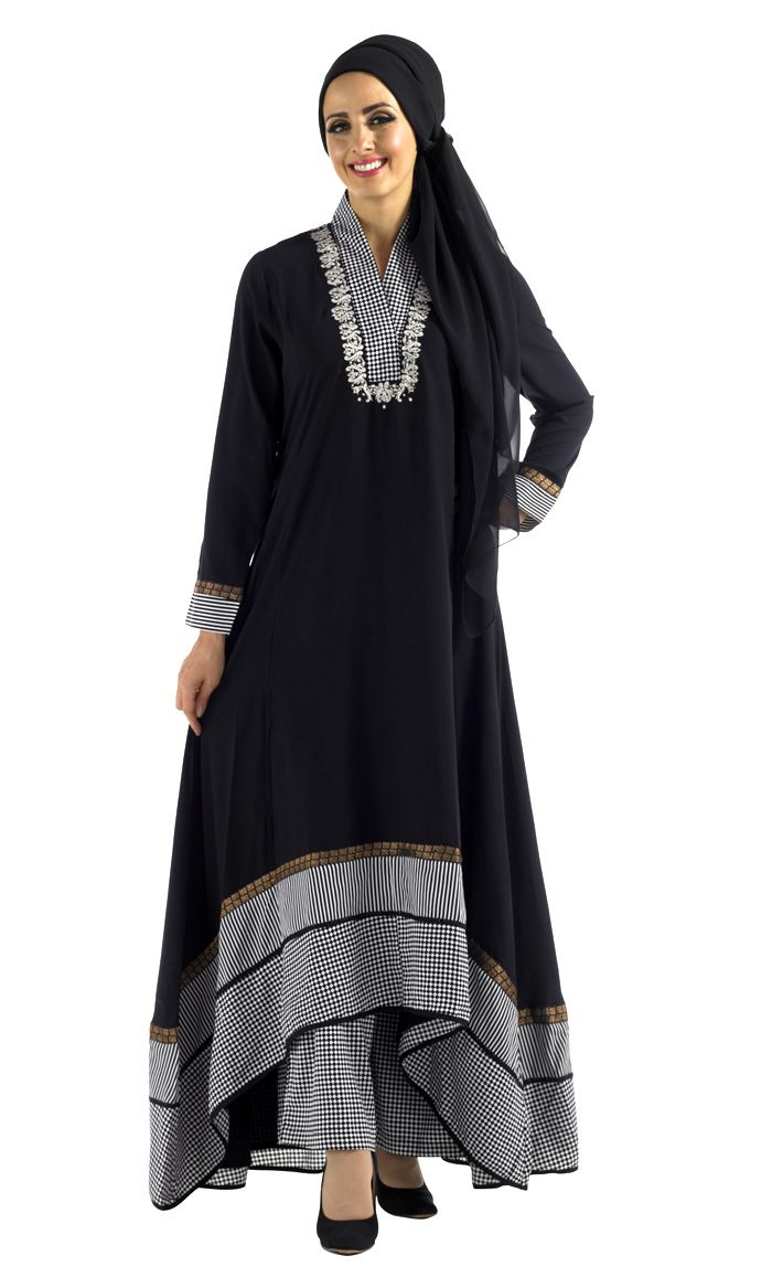 Black Print Shlawar Kameez Set 2 Piece Set Includes Dress and Pants (Scarf NOT included) Princess cut sihlouette, Scalloped Bottom (Back is longer than front) 4 different trims along Neckline, sleeves and Hem. Pants in checkered print