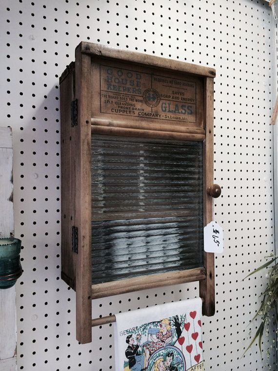 This handmade cabinet constructed from a vintage soda box and antique washboard adds rustic flair with functionality to any home. Perfect for cozy bathrooms or kitchens. Complete with new hanging hardware for easy installation. One of a kind and just too cute!! Dimensions: 22 tall X 12.5 wide x 6 deep.