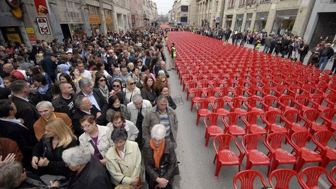 Red chairs are displayed along main street in Sarajevo to mark the 20th anniversary of the start of the Bosnian War on Friday, April 6, 2012. City officials have lined up 11,541 red chairs arranged in 825 rows along the main street that now looks like a red river. Nobody will be sitting in them since the concert being held is for 11,541 Sarajevans who were killed during the siege.(SULEJMAN OMERBASIC / AP)