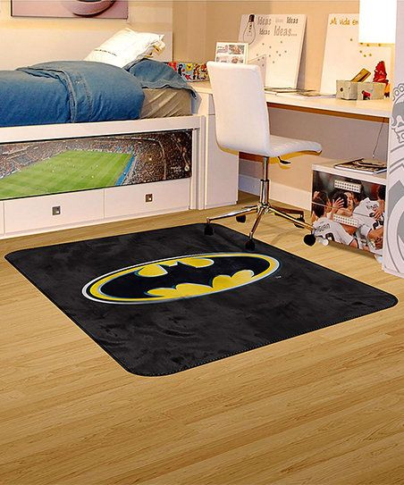 Tie together décor in superhero fashion thanks to this plush area rug adorned with the iconic Dark Knight emblem.