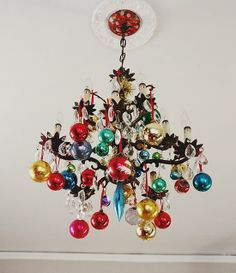 Swinging From the Chandelier: Peaches from Aunt Peaches decided to add a festive spin to her chandelier. It's now dripping with crystals and colorful ornaments — we approve!   Source: Aunt Peaches