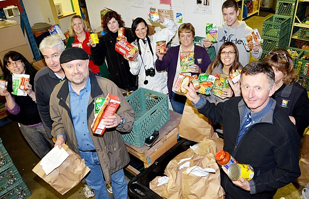 Pitt Meadows City staff and elected officials came to the Friends In Need Food Bank on Monday to help sort food. They were joined by TIMES staff who also helped in the sorting process. Both had collected food for the food bank.