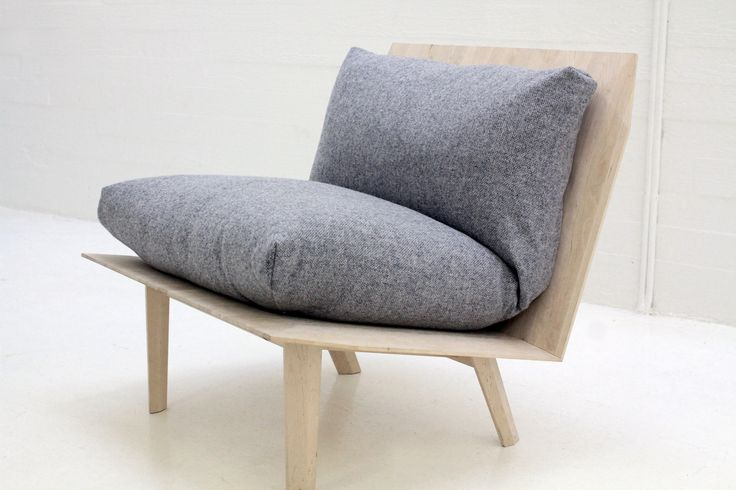 Hover Lounge Chair by Ateljé Sotamaa is a soft, robust, comfortable piece of furniture. The design is based on the idea of contrast between the geometrical wood surfaces and the plush, non-geometrical wool pillows. Our ambition was to create a piece of design, which is easy to approach, but at the same time triggers your intellect by refusing an easy categorization.