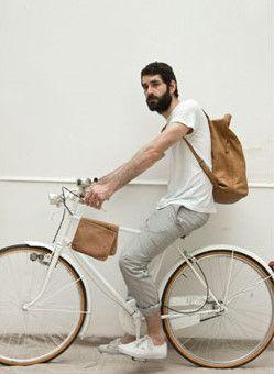 a boy with a beard on a bike