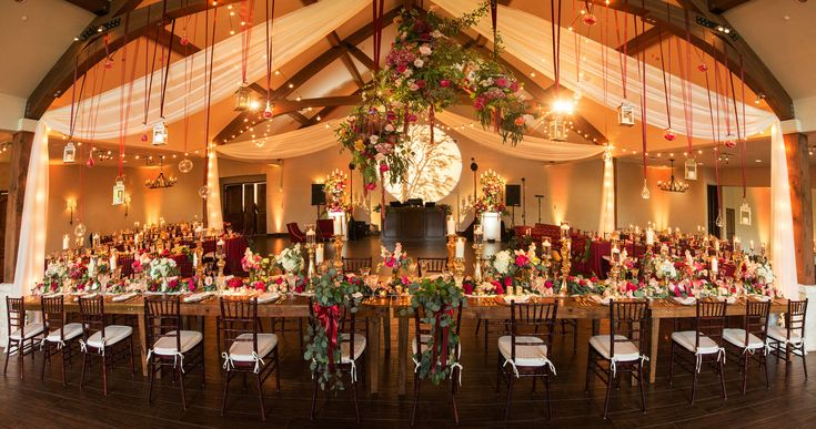 Weddings by StarDust | STUNNING Reception space utilizing the arches in the building as a base for hanging florals and lights. | Wedding Planner in Dallas Fort Worth Texas | 972-781-1619 #weddingplanner #weddingplanners #wedding #weddings #weddinginspo #weddinginspiration