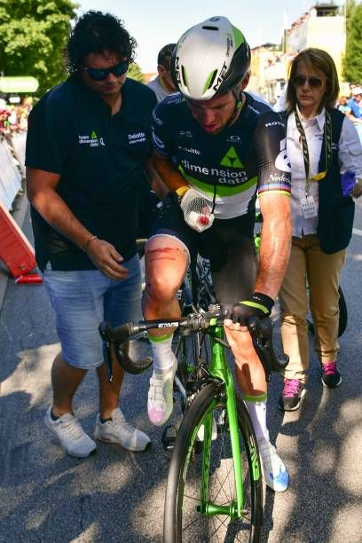 Great Britain's Mark Cavendish injured restarts after falling near the finish line at the end of the 2075 km fourth stage of the 104th edition of the...