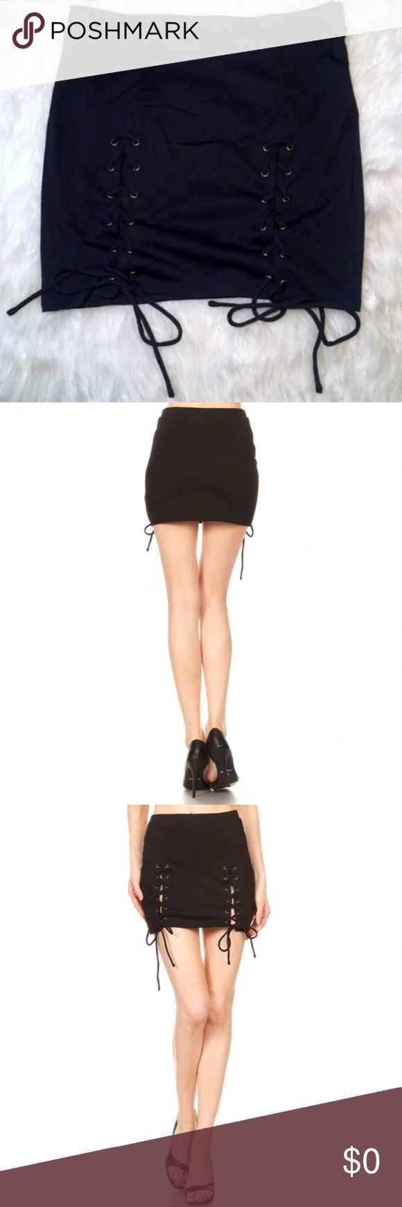 COMING SOON! Black Lace-Up Skirt Solid black skirt. Elastic high waist with lace-up string detail that ties at the bottom. Body-con/fitted style.  65% Rayon 35% Polyester Sugar Punch Couture Skirts Mini
