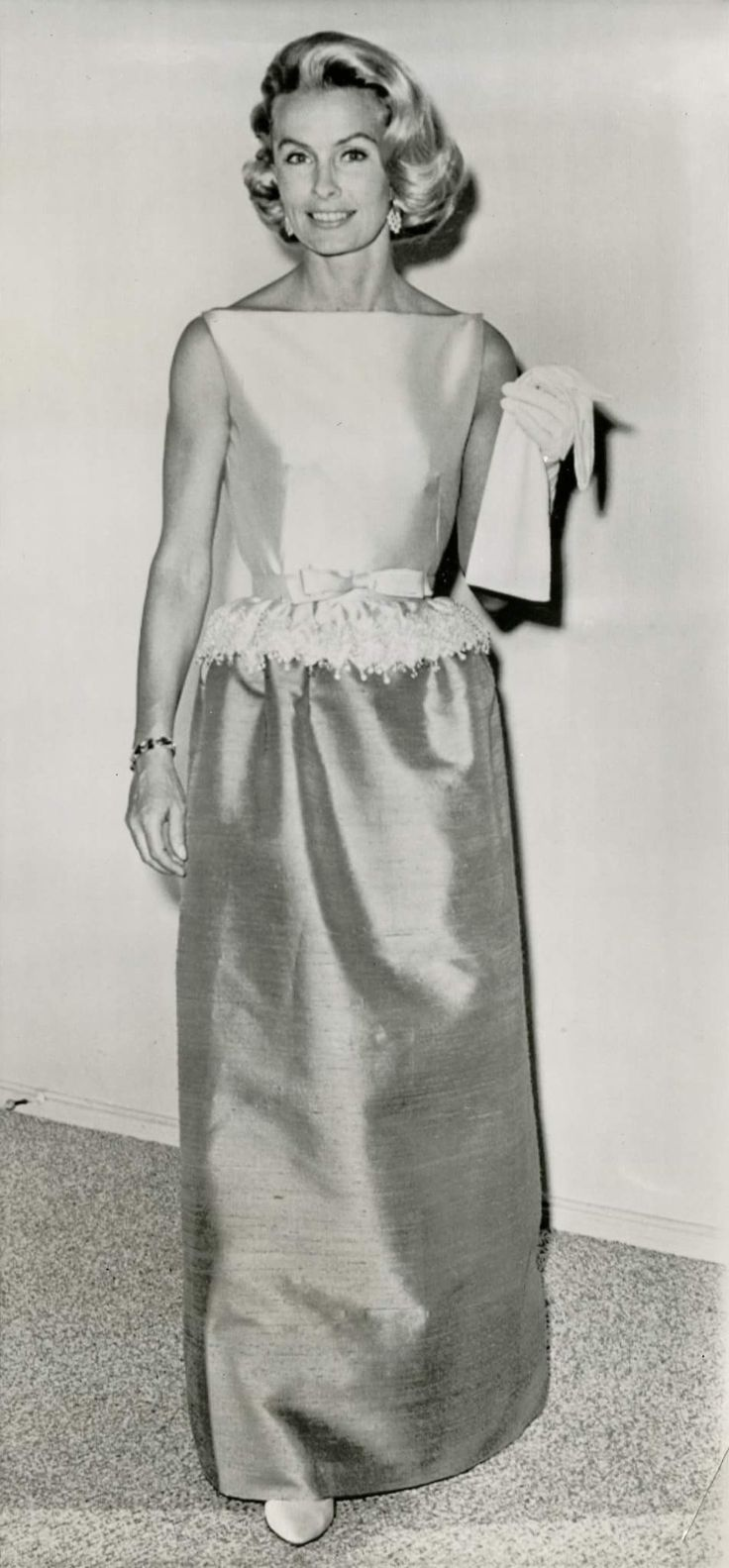 Dina Merrill wearing the same dress Jackie wore to the State Dinner for the Shah of Iran