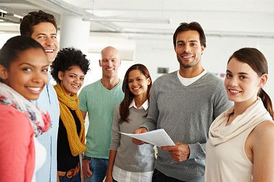 Shot of a diverse group of colleagues in an office - stock photo #1211076