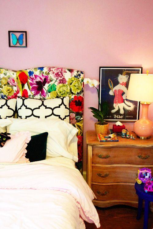Designer Guild floral headboard, black/white trellis pattern, green velvet bolster, vintage wood dresser, pink walls
