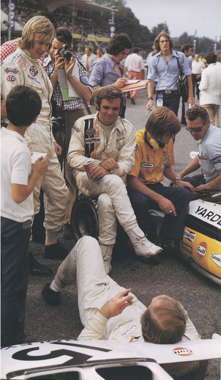 "jacqalan: ""Relaxing scenes from Formula 1 in the early seventies.Between the qualifying sessions Ronnie Peterson,chats to Peter Revson and Denny Hulme (lying down). Monza 1972. ( Photo by Paolo..."