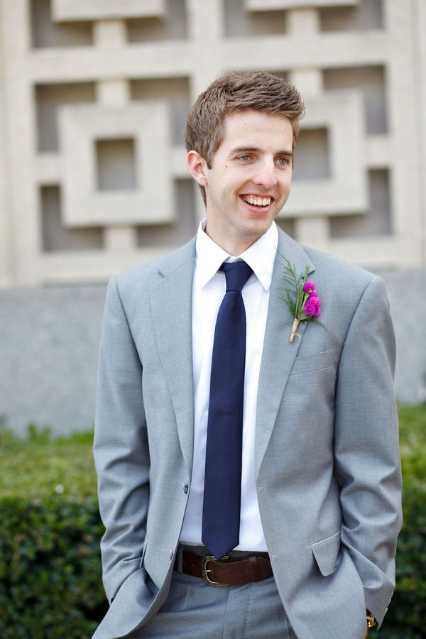 groom in gray with pink