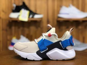 e77ffabc2678 Womens Nike Air Huarache City Low Desert Sand Dark Obsidian Blue Nebula  White AH6804 006 Running