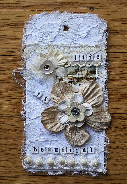 shabby chic altered tag! i would maybe spritz the lace with some sparkly color.
