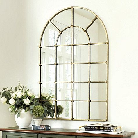 Create the illusion of a Palladian style window and fill your room with reflected light with our dramatic Grand Palais Arch Mirror. Twenty-two faux mullion panes are accented at the corners with textured medallions.Grand Palais 54 Arch features: One piece designHand crafted Steel frame