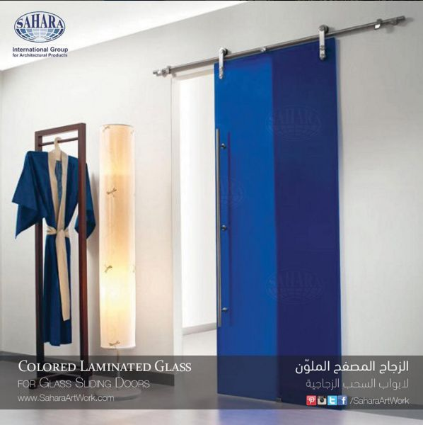 a beautiful interior sliding door made from colored laminated glass to suit the modern interior