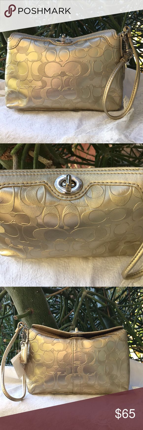 "New! Gold Coach Wristlet New!  Authentic  Excellent condition.  Signature Coach logo.  Inside pocket Silver hardware Twist closure Coach tag Color = Gold Pink interior  Length: 8"" Depth: 5"" Width=1.5""  Handle+6"" Coach Bags Clutches & Wristlets"