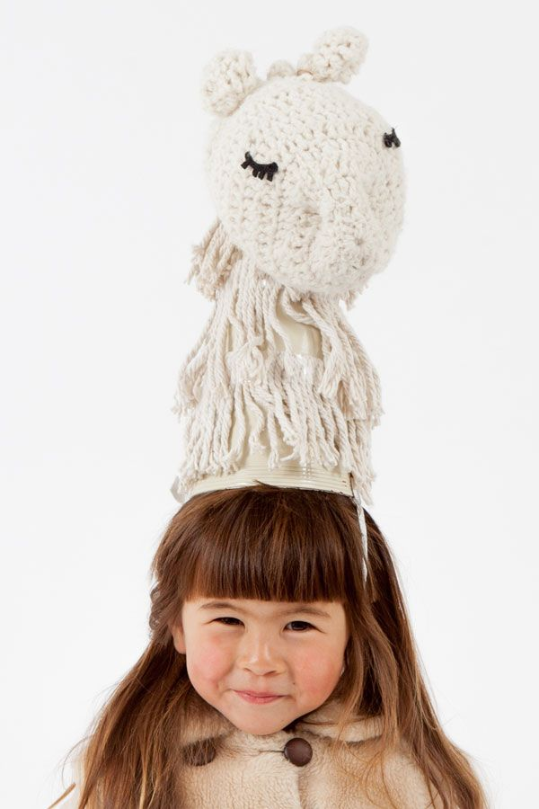 How to cobble together the cutest little llama costume (surprise: it starts with an old mop!). #DIY #halloween