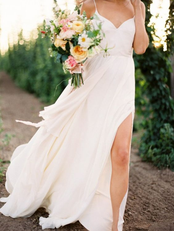 flowy spaghetti strap wedding dress with a side slit