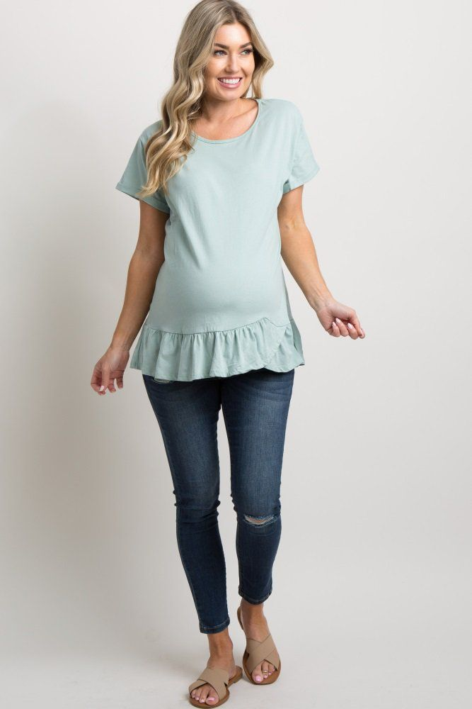b7bd3f5f08fcc Mint Solid Cuffed Ruffle Trim Top A solid hued maternity top featuring a  ruffle trim with