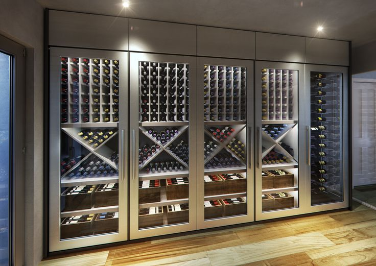 Another magnificent custom contemporary wine cellar display was designed for a very special client. His knowledge of the wine process in addition to his love of wines far surpasses your average wine collector. Coming from a family of vineyard owners and c