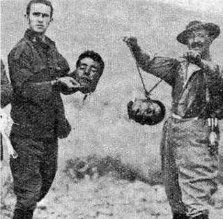 French soldiers in Algeria, 1950's and '60 s, posing with the heads of the captured 'rebel' Algerians.