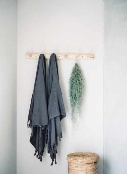 The knotted towels are from Tine K Home; the airplant is a Tillandsia that often pops up in Pearl's photoshoots.