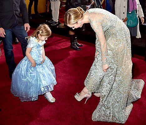 Ian Ziering's daughter Mia and Lily James compare shoes at the premiere of Disney's Cinderella on March 1, in L.A.