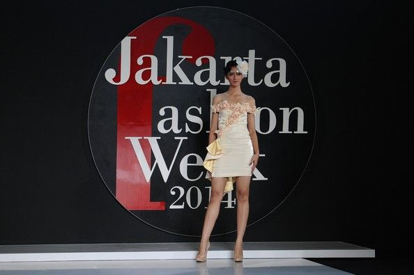 A Thai model showcases designs by Amata of Thailand on the catwalk during Jakarta Fashion Week 2014 at Senayan City in Jakarta...