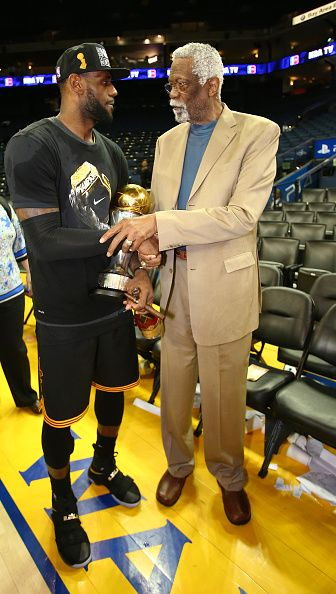 LeBron James of the Cleveland Cavaliers talks with Hall Of Famer Bill Russell after Game Seven of the 2016 NBA Finals against the Golden State...