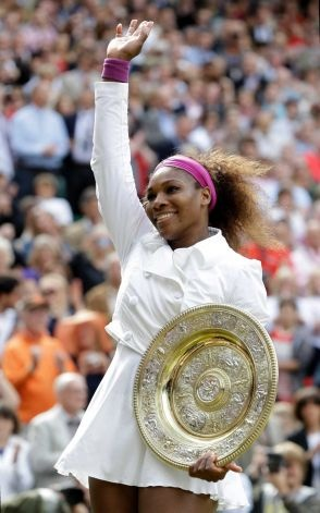 Serena Williams of the United States celebrates with the trophy after defeating Agnieszka Radwanska of Poland to win the women's final match at the All England Lawn Tennis Championships at Wimbledon, England, Saturday, July 7, 2012. Photo: Kirsty Wigglesworth / AP   #5th Wimbledon #14th Grand Slam......congrats!!!!!!
