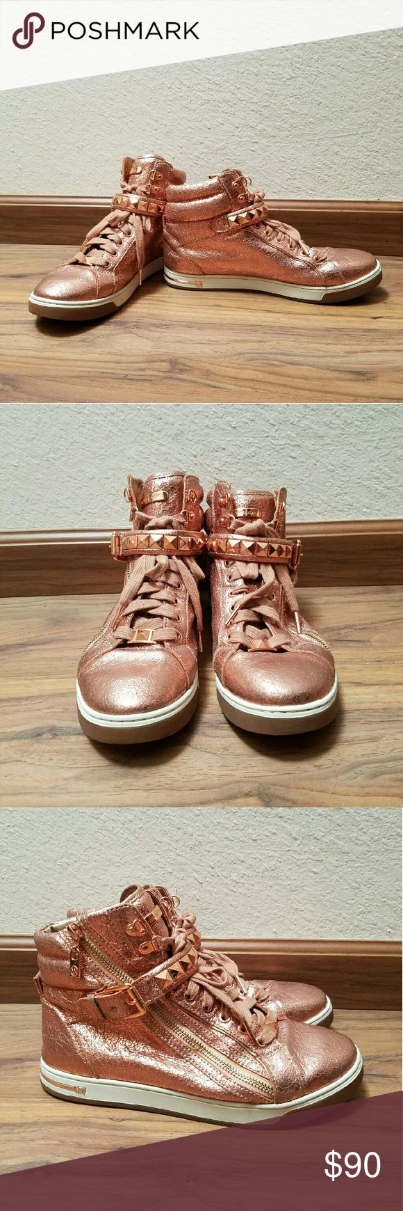 Michael Kors rose gold high top sneakers Michael Kors rose gold high top sneakers. Side zip with studded strap. Worn only a few times. Comes from a smoke free and pet free home. Michael Kors Shoes Athletic Shoes