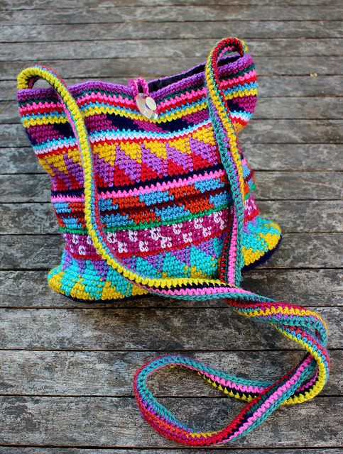 This crochet purse caught my eye right away because it is absolutely stunning!  I love the use of color, and especially love how this bag is a stash buster. Imagine the color possibilities!  I like us