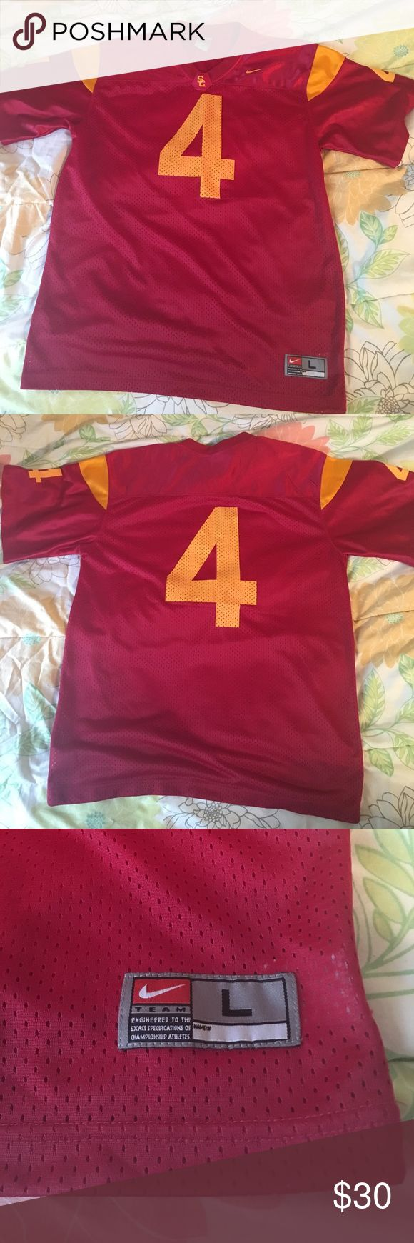 NWOT USC Nike Football Jersey #4, size large This Nike college football jersey is brand new without tags. It is a size large (I believe it's unisex, so it could also fit smaller men). It is University of Southern California. It has the number 4 on both front and back. Nike Tops