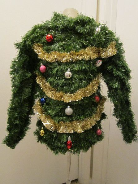 The ugliest of all ugly Christmas sweaters. @Erin Whitaker just wrap yourself in garland, hang some ornaments and add some tinsel!!!!!: