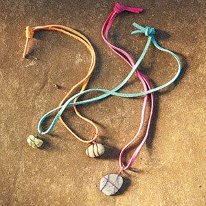 Rock Necklace Need a no-mess craft? A plain rock becomes a piece of jewelry without even a drop of paint. Wrap a small rock with wire in your grandchild's favorite color and attach it to a leather cord for instant DIY style. Get the instructions: Spoonful.com
