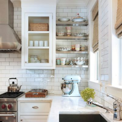 Take that subway tile from the countertop all the way to the ceiling trim to extend the backsplash.