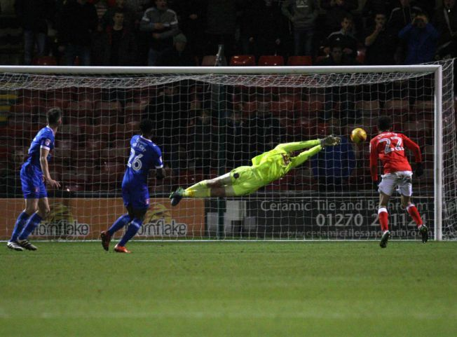 Gillespie save at Crewe