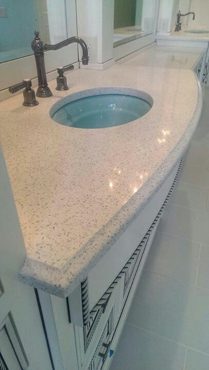 Stellar white quartz on the bathroom counter with ogee