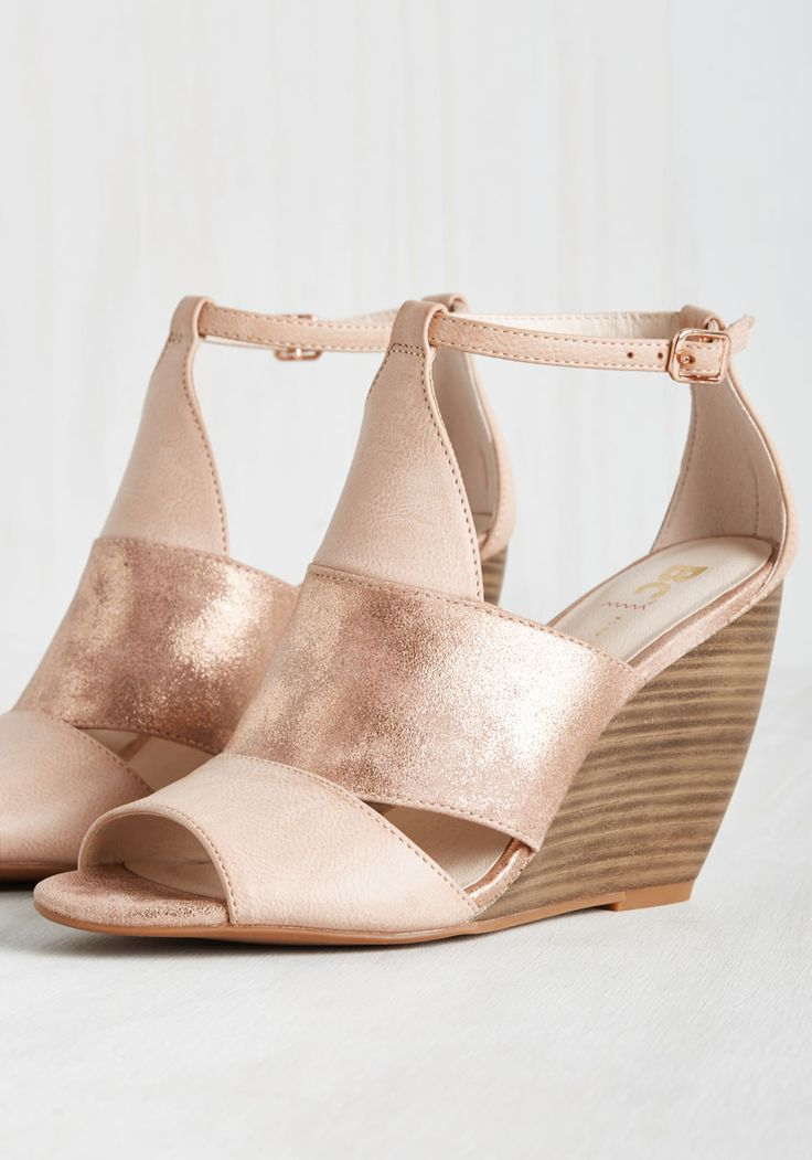 Be an energetic vision of style from the get-go by stepping out in these pastel pink wedges by BC Footwear! With faux-leather straps that alternate solid and metallic bands, a delicate rose gold buckle at each ankle, and stacked heels, these glimmering kicks keep your enthusiasm for your ensemble high all day long.