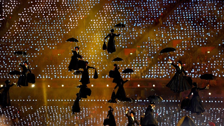 Mary Poppins performers float inside the Olympic Stadium