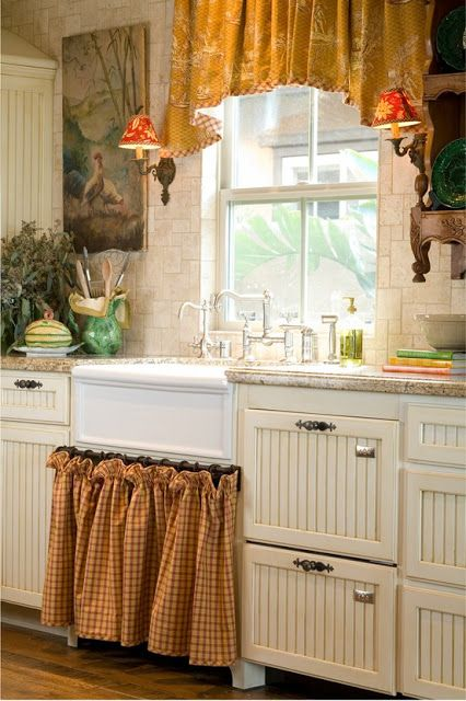 Cottage kitchen, sconces, farm sink, window treatment.  Love the little sconces.